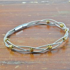 A gift for the music lover. Braided Recycled Guitar String Bracelet w/ Brass Ball End Beads on Etsy, $29.00