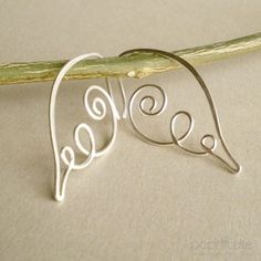 For new/small piercings, 20 gauge is a better choice for earrings. THIS LISTING IS FOR A PAIR OF ANGEL WING EARRINGS IN 20 GAUGE. Made of Argentium Silver Wire.        Angel Wing Earrings in 18 gauge