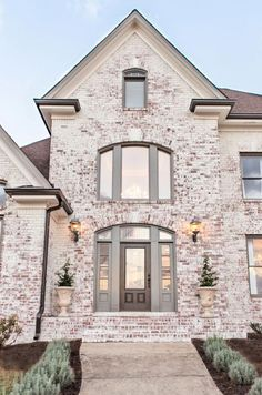 36 Wonderful Brick Exterior House Design Ideas - Tired of the busy lifestyle in the city? Do you want to get out a little from the hectic life? If ever you want to build a country house that will mak. Home Exterior Makeover, Exterior Remodel, Whitewash Brick House, Whitewashing Exterior Brick, Brick House Trim, Painted Brick Exteriors, Painted Brick Houses, White Brick Houses, Brick Colors