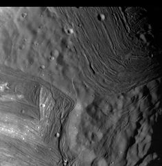 """This photo of Uranus' moon Miranda, taken by NASA's Voyager 2 probe in January 1986, shows an unusual """"chevron"""" figure and regions of distinctly differing terrain on the mysterious satellite. Credit NASA/JPL"""