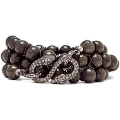 Love this olive Renee Sheppard Snake Bracelet. She knows how to make a snake look good on your wrist.