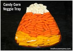 candy corn veggie tray! :) (this page has all kinds of cute ideas for decorating for Halloween with candy corn!)