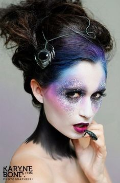 this is pretty- how they blended her colorful makeup into her hair. definitely a technique to use!