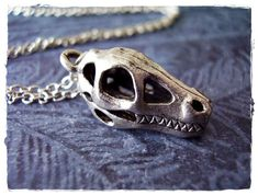 Tiny Fossil Dinosaur Skull Charm Necklace in Antique Pewter with a Delicate 18 Inch Silver Plated Cable Chain