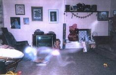 This photo, taken in the early '80s, features a young girl playing in the living room. When the photo was developed, the father found a disturbing image of a ghostly figure crawling near his daughter