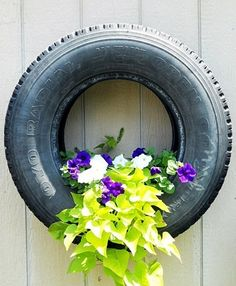 Petunias and sweet potato vine planted in tire (1) From: Moonlight Rainbow, please visit