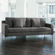 A highly contemporary range, the designer sofas in the Oslo range feature large plush back cushions for support and a tough but soft material cover. The sofa is supported by sturdy stainless steel legs, for a sleek finish. There is an armchair and a corner sofa to match.