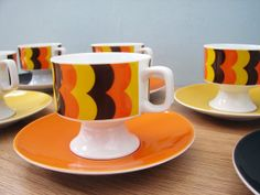 1970s Retro Eschenbach Cups and Saucers set.  I just love this set of six 1970s cups and saucers. They are so retro in the classic orange yellow and brown colours so provocative of the 70s.  This set is made by a company called Eschenbach, in Bavaria, Germany.  The set include 6 x coffee cups and 6 x saucers, all with makers mark stamp.  Would look great in a retro kitchen on display on a wooden retro sideboard.