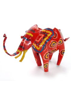 """Small Tin Elephant. The elephant signifies strength, royalty, dignity, patience, wisdom, longevity, and happiness. Highly revered for its intelligence, the elephant also has a strong sense of loyalty and community. A powerful symbol of good fortune, keeping a lucky elephant in your home is thought to protect you from bad luck and stimulate prosperity in your life.    Height: 4.5""""   Length: 7""""   Width: 3.5""""   Artist: Mkankha Brothers   Made In: Zimbabwe. $24.00"""