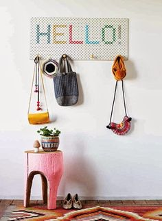 Embroidered sign...so great!  And the little end table is adorable