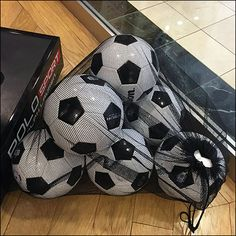 The visual merchandising angle I get. A mesh bag mass of Soccer Balls to help set a window dressing theme. But as American, Soccer itself… Soccer Store, Store Fixtures, Visual Merchandising, Mesh, Balls, Dressing, Window, American, Windows