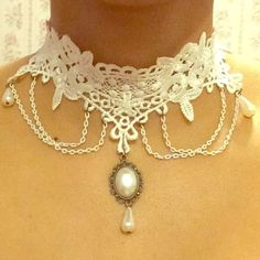 Ornate white lace choker necklace Ornate white lace choker necklace with 4 dangling white chains, 2 faux pearl tear drops and center faux oval pearl with faux pearl tear drop. Clasp is a bronze color and came that way. Brand new with tags, never been worn ❌no trades❌ please use the offer button if you'd like to negotiate thank you  Jewelry Necklaces