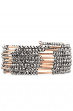 Spiral Bangle - a coil of alternating rose gold plated brass tubes and metallic faceted beads give the look of stacked bangles.