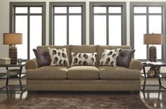 This contemporary Ashley Furniture sofa features plush foam cushions, warm accent pillows, and earth-toned upholstery that has a casual and comfortable style. This sofa is perfect for creating a welcoming living room to play games, watch movies, and hang Ashley Furniture Sofas, Bed Furniture, Furniture Design, At Home Furniture Store, Furniture Outlet, Discount Furniture, Living Room Decor On A Budget, Living Room Designs, Queen Sofa Sleeper