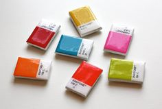 DIY pantone chip magnets ... made from small white tiles, hand painted and then adhered with a magnet sheet behind. ... adorable! perfect for craft room especially!