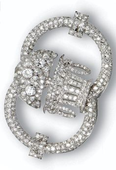 An Art Deco diamond brooch, Lacloche, Paris, circa 1920. Designed as a flower-filled basket within a double-hoop frame, set throughout with numerous old European-cut and single-cut diamonds, mounted in platinum, signed Lacloche, made in France, numbered. #Lacloche #ArtDeco #brooch