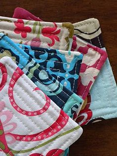 How to make quilted coasters. Great use of scrap fabric. Make them a little bigger & they could be hot pads for the table.