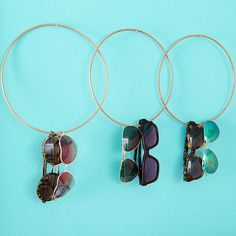 Keep your favorite sunglasses on display so you can see your options literally hanging in front of you oh this DIY sunglass holder! This is also a good way to protect your pair from being lost, scratched, or broken. - DivineCaroline.com