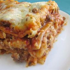 "Easy Lasagna II | ""This was a really good recipe - the family said it was restaurant quality:) I boiled the noodles first and added mushrooms to the meat and sauce (always trying to add veggies in for the kids)."""