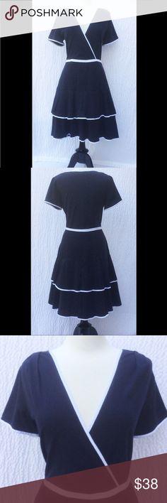 "New EshaktI Navy Fit & Flare Midi Dress XL 16 New Eshakti navy fit & flare jersey knit dress. Size XL 16  Measured flat: Underarm to underarm: 40""  Waist: 34 ½"" Length: 40""  Eshakti chart for bust size XL 16: 41 ½"" Surplice neck w/ contrast piped trim, seamed piped waist, side hidden zipper. Flared tiered skirt, side seam pockets. Cotton/spandex, woven jersey knit, light stretch, medium weight. Machine wash. eshakti Dresses Midi"