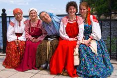 "Smiling    Girls in ethnic Russian dress    Ethnic Museum ""Khokhlovka""  Near Perm, Russia    Trinity Holiday, June  http://www.flickr.com/photos/sulde/5616622015/"