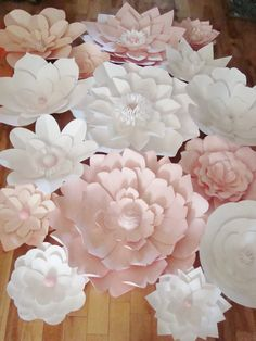 Paper Flower Backdrops are a cool and refreshing way to enhance the decor for your wedding or event. We send you the flowers and you use them to create a dream DIY backdrop for your event. Flowers come completed (no assembly required). Offering 15 paper flowers in your choice of up to 5 colours and matching paper and/or jewel centres. Includes: - 2 30 inch paper flowers - 1 24 - 26 inch paper flower - 3 14 inch paper flowers - 2 15 - 16 inch paper flowers - 3 18 - 20 inch paper flowers - 4…