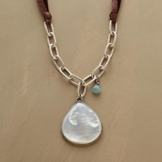 SEASIDE NECKLACE -- Our homage to the sea keeps it simple with a smooth mother-of-pearl teardrop flanked by textured sterling links and a single aquamarine. Leather cord, toggle closure. Handmade in the USA. Exclusive. 18L.