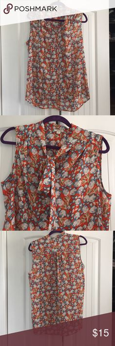 Pleione Blouse Orange and purple flowered button down blouse. Great for work or out with friend. Lose fitting. Pleione Tops Button Down Shirts