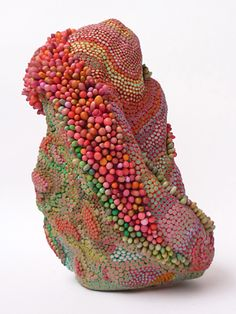 sculpture by Angelika Arendt. Lovely colors and interesting form. Could i get similar results with beads on a rock?