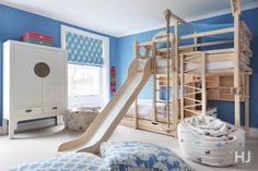 Every little boys dream bedroom! The walls are painted in Farrow & Balls 'Cook's Blue' and the fabrics are all from Korla home. Home Journal, January 2014