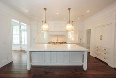 white kitchen with brass fixtures