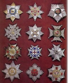 I shall come back to identify these - a few of these are versions of the badges designated and associated with the Order of Malta (From: http://i33.tinypic.com/2qx3zte.jpg)