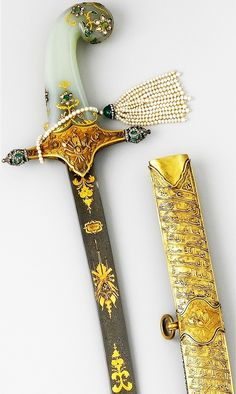 Ottoman kilij, 19th c, Persian wootz steel blade, scabbard with gold, diamonds, emeralds and pearls, jade handle, a ceremonial sword used for an investiture ceremony, symbol of the luxury, extravagance and workmanship in the Ottoman Empire, said to have been made in 1876 for the investiture of the Ottoman sultan Murad V (reigned May 30–Aug 31, 1876). He suffered a nervous breakdown before the ceremony and was deposed and imprisioned until his death in 1904, L. 39 3/4 in. (100.97 cm), Met…