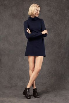 "Long sleeved navy turtleneck mini dress featuring a flared hem. - Ponte Roma, 74% rayon, 20% nylon, 6% spandex - Fits true to size - Model is 5'10"" and is wearing a small Handmade in Los Angeles"
