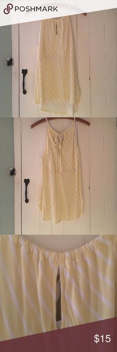 👍🏾one day sale🎉🎉Yellow and white top High adjustable neckline. Has ties that tie in a bow in the back to adjust the fit just right for you. Front has a cute slit cut out in the top New York & Company Tops