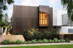 Home in WA by Weststyle Design & Development. Overall effect. White, grey, natural wood, square, lots of natural light, open.