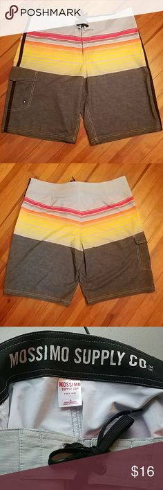 🌞MONDAY SPECIAL💛Mossimo board shorts🌞 Sexy gray with red and yellow stripes and a dark gray bottom.. Left Velcro pocket and velcro tie waist. Size 36 Mossimo Supply Co Swim Board Shorts