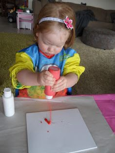 Toddler colour mixing on canvas