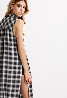 High-Slit Plaid Shirt Dress  Again, I'm not a fan of shirt dresses, especially long dresses, but this one is adorable! It is perfect, with plaid and a long slit for the perfect pants underneath or even cute shorts.