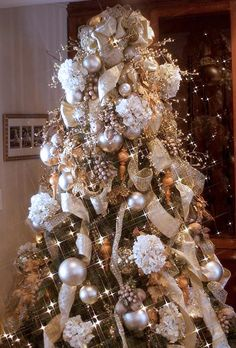 A tree with lots of sparkle! -- I like the addition of the matte ornaments and white floral accents.