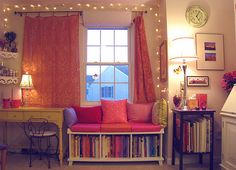 I love the lights around the top, the pink and purple color scheme, and the BOOKS