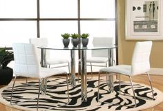 """The Hammarshee Dining Collection features a 45"""" round tempered glass table top. The Table has a metal and glass composition with round chrome legs. The Chairs are white faux leather and have matching chrome finished legs.   Contemporary Style Metal and Glass Composition White Faux Chairs Chrome Finish Legs"""