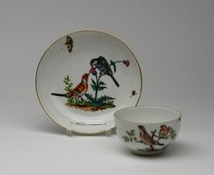 Cup and Saucer with Large Groups of Birds.   Meissen. Circa 1760.     Porcelain, enriched in colours and in gilt. Each piece shows a group of wild birds on a naturalistic perch, interspersed with insects. Height 5cm/ + 13,5cm. Condition A.   Crossed swords mark. Cup with press number 4, saucer with 53.