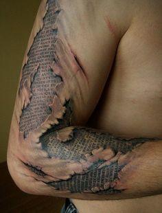 ripped skin text tattoo