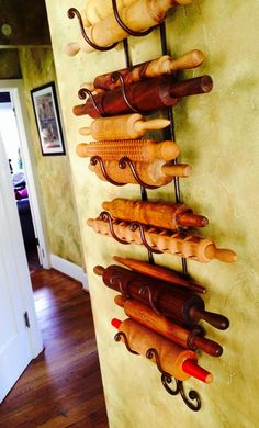 Must have in my home someday!! Vintage rolling pins on a wine rack. Going to start my collection now...