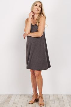 This pretty sleeveless maternity dress is the ultimate essential piece for your closet this year. A sleeveless cut for the warmer weather and an ultra soft material to keep you comfortable. Dress this maternity dress up with heels and a statement necklace, or dress it down with sandals and a floppy hat for a casual look.