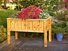 Build this planter box to accommodate your height, making for easy access and tending to your flowers and vegetables. Forgoing the traditional box shape with legs stuck on the inside corner, the designer moved the 4x4 legs to the outside and in line with the side panels. Panels made using common deck lumber. Its possible yo might even be able to build this with left overs and scraps from a deck build. As low as $5.95 #diy #woodcraftpatterns