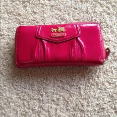 Coach wallet Dark pink with gold coach symbol. Very spacious wallet! It will fit lots in there and still able to close the zipper. There's a few marks on the back from being used but not that bad (third picture) Coach Bags Wallets