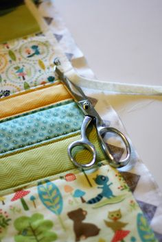 Basic Baby Quilt Tutorial.  Cute prints, nice tutorial, but I have to add that I always use quilters gloves when I machine quilt.  It's the only way I can control all that fabric.