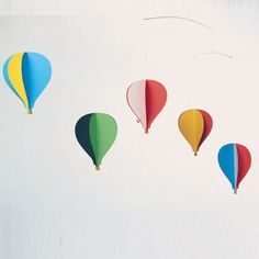 have the metal pieces from MB's old mobile, attach hot air balloons for decor for his party.
